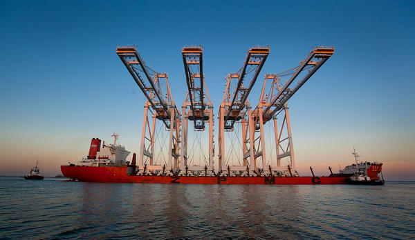 A Shanghai Zhenhua Heavy Industry Co. Ltd. (ZPMC) ship delivers new container cranes to the Port of Long Beach in Long Beach, California, U.S., on Monday, July 9, 2012. The U.S. Census Bureau is scheduled to release trade balance data on July 11.