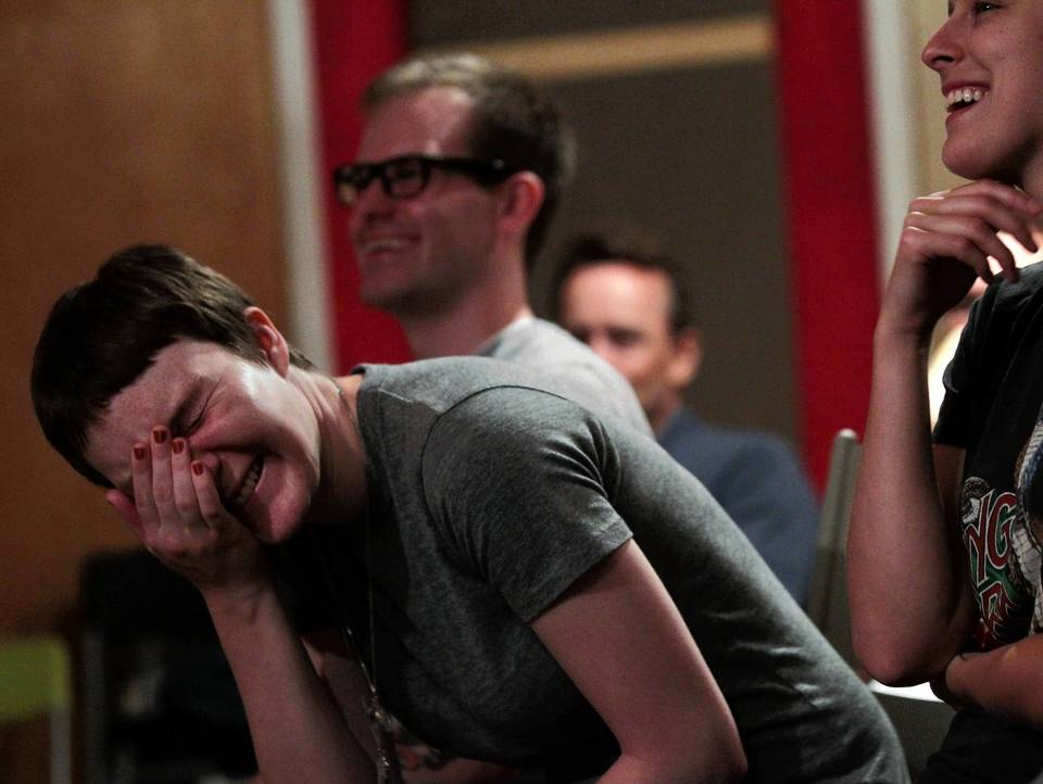 Sara Collins laughs while comedian Stephanie Hasz performs during the standup mixtape podcast recording at Million Yen Studios.
