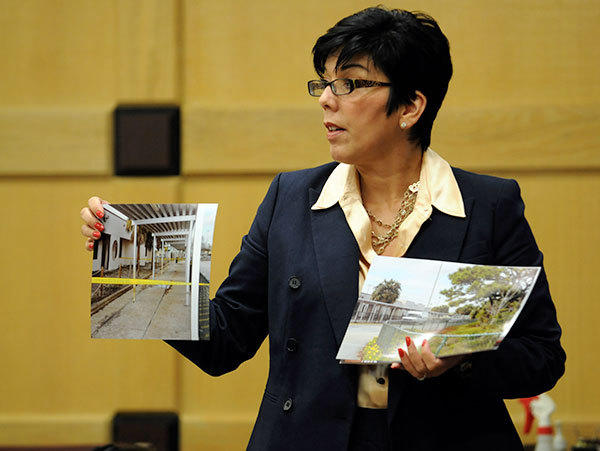 Assistant State Attorney Maria Schneider  holds up a photograph of the area where the attack on Josie Lou Ratley took place at Deerfield Beach Middle School on March 17, 2010 during the second day the first degree attempted murder trail of Wayne Treacy, accused of trying to kill Josie Lou Ratley by stomping on her head while wearing steel-toe boots.