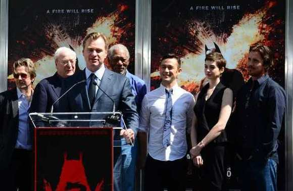 "Director Christopher Nolan, shown with the cast of ""The Dark Knight Rises,"" has declined Warner Bros.' entreaties to produce a ""Justice League"" film."