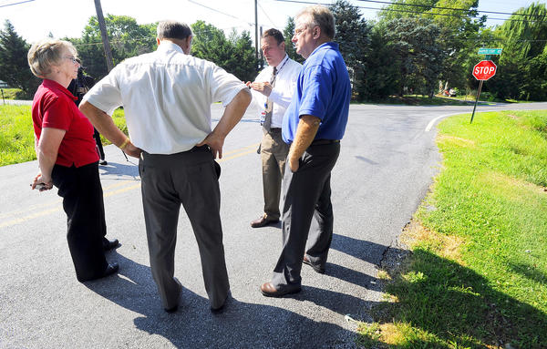 Washington County Public Works Director Joe Kroboth, second from right, talks with Washington County Commissioners Jeff Cline, right, Bill McKinley, center, and Ruth Anne Calaham, left durinng a bus tour of county roads Tuesday.