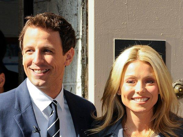 "Actor Seth Meyers, left, and TV personality Kelly Ripa tape a segment for ""Live! With Regis And Kelly"" at the ABC Lincoln Center Studios on April 18, 2011, in New York City"
