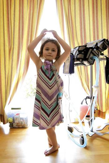 Sydney Peterson, 5, shows off her ballet skills Friday in her Lisle home. She is on a ventilator for a medical condition that requires 24-hour care.