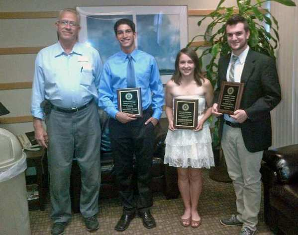 Crescenta-Canada Rotary President Robert Ippolito, from left, with scholarship recipients Brandon Baum, Jackie Kershner and Austin Hunt.