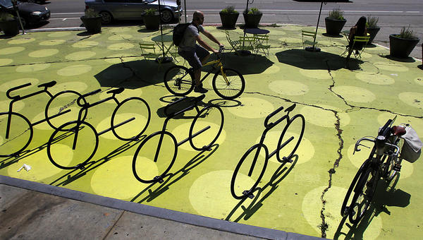 Caption: Silver Lake's Sunset Triangle Plaza provides a motor-free respite for the bustling block. (Luis Sinco / Los Angeles Times)