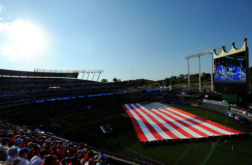 A general view as a large American flag is unfurled on the field before the 2012 MLB All Star Game at Kauffman Stadium.