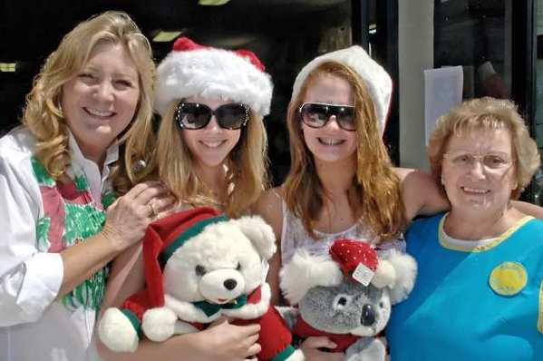 Although 171 days early, from left, Deborah Spang, Haley Gertner, Kamiryn Muhlenbruk and Lorelei Kelley were in the holiday spirit for the guilds 'Christmas in July Mega Sale.'