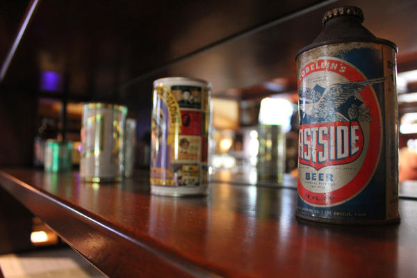 Old beer cans line a case at the Story Tavern.