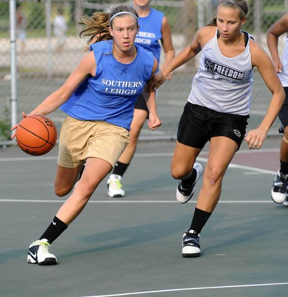 Southern Lehigh's Madelene McDonald (24) dribbles against Freedom's Jasmine Vass (12) in their first-round game at the kick off the Stellar girls varsity basketball tournament at Cedar Beach Park on July 6, 2011.