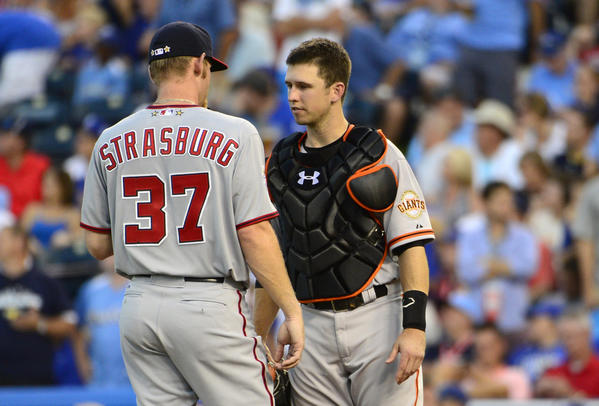 NL battery mates Buster Posey and Stephen Strasburg chat in between pitches.
