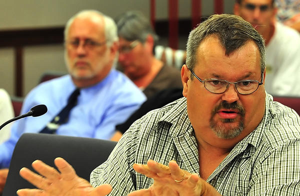 Joe Frey addresses revisions of the proposed animal control ordinance Tueday evening during meeting of the Washington County Board of Commissioners. At rear is Humane Society of Washington County Executive Director Paul Miller.