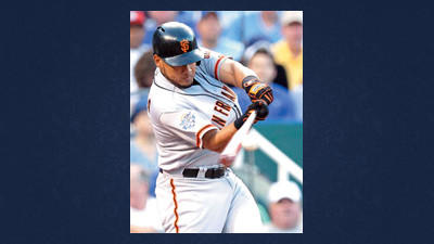 National League's Melky Cabrera, of the San Francisco Giants, hits a two-run home run during the fourth inning of the MLB All-Star baseball game Tuesday in Kansas City, Mo.