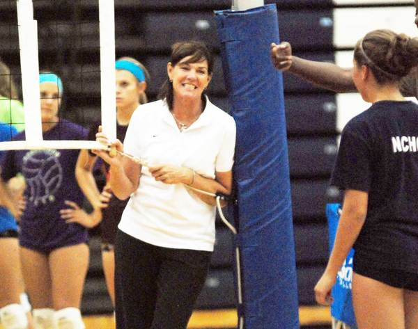 Michigan State University volleball coach Cathy George (middle) smiles during a break in the action at the Petoskey Volleyball Camp Tuesday at the Petoskey High School gym.
