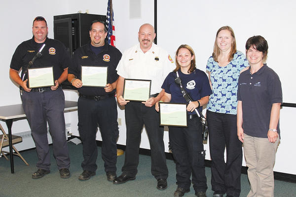 Community Rescue Service providers receiving EMS Excellence in Care 2012 awards were, from left, Shawn Wieczorek, Justin Ruppenthal, Robert Buck and Alyssa Sica, from presenters Kelly Llewellyn, EMS administrative specialist for Meritus Health, and Corey Thomas, trauma registrar for Meritus Health. Not pictured: Billy Woods.