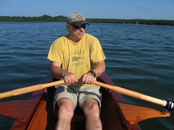 John Yothers paddles a wooden kayak he built himself
