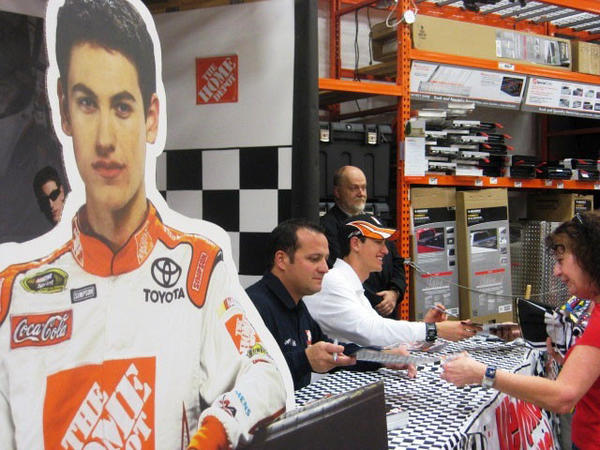 With one of his life size cardboard cutouts looming over a line of fans, 18-year Middletown native Joey Logano signs autographs along with his crew chief and Berlin native Greg Zipadelli during an appearance Wednesday at a Home Depot store in Port Orange, Fla., in 2008.