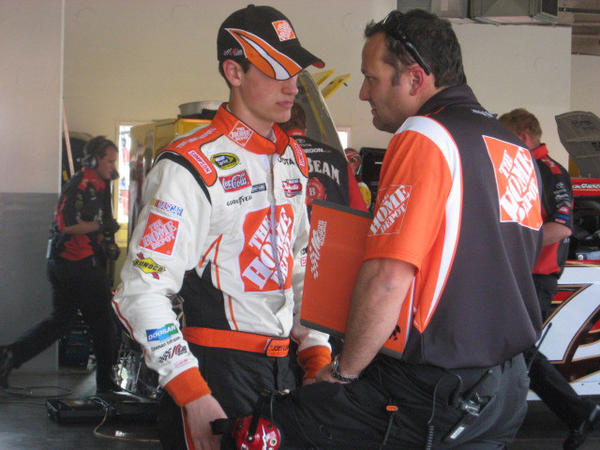 Eighteen year old Middletown native Joey Logano talks with his Joe Gibbs Racing crew chief and Berlin native Greg Zipadelli after Daytona 500 practice Wednesday at Daytona International Speedway in 2008.
