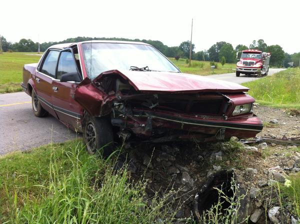 A 1991 Buick sits along Ky. 501 Tuesday morning after colliding with a concrete culvert. The driver of the car, 86-year-old Bertha Vanhook, died later of blunt force trauma while doctors were preparing to operate on her at a hospital in Lexington.