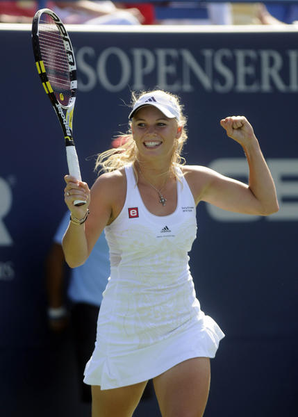 Caroline Wozniacki celebrates match point as she defeats Nadia Petrova, 6-3, 3-6, 6-3 in the women's final at the Pilot Pen Tennis Tournament.  It was Wozniacki's third consecutive championship title.