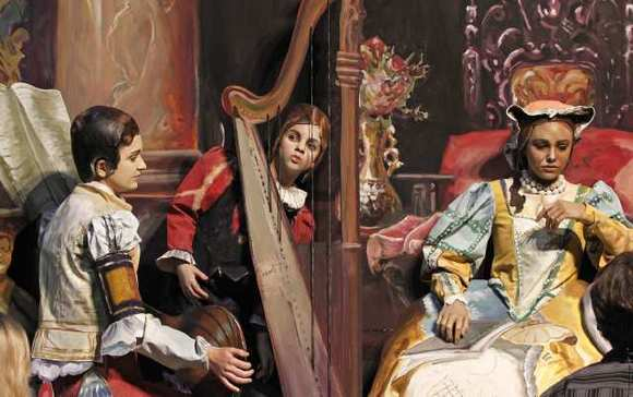 "Samantha Thomas, middle, looks through a harp in the ""Galileo at the Court of Isabella"" scene during media preview night for the Pageant of the Masters show."
