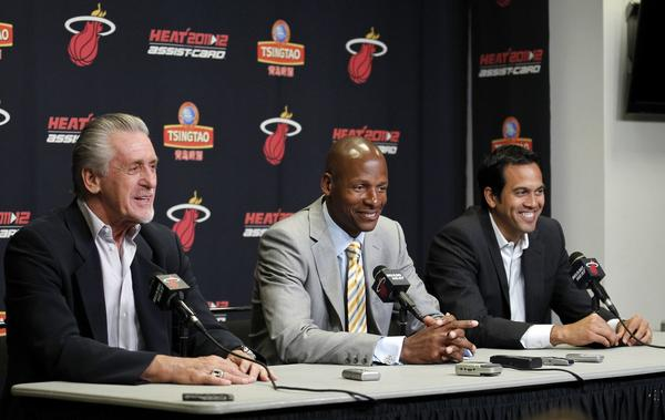 Ray Allen (C) takes part in a news conference with Miami Heat President Pat Riley (L) and head coach Erik Spoelstra after Allen signed with the Miami Heat NBA basketball team in Miami, Florida July 11, 2012. Allen joins the Heat after leaving the Boston Celtics.