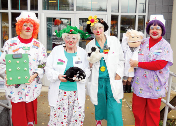 Dressed in health-care attire, clowns visit patients at Windber Medical Center.