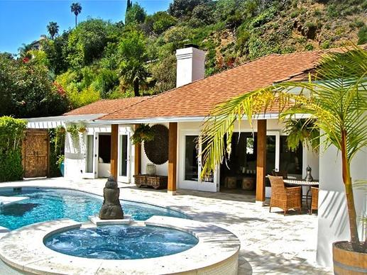 The celebrity and fashion photographer has listed a house in the Hollywood Hills West area at $2.325 million.