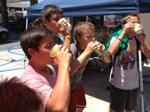 Kids compete in a Slurpee contest at the new store on Foothill Boulevard.