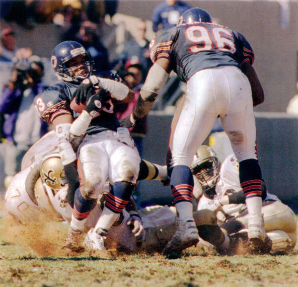 Shaun Gayle is tackled by New Orleans' Chris Port (70) and Quinn Early (on ground) after recovering a fumble in the Bears' 17-7 victory Oct. 9, 1994, at Soldier Field.