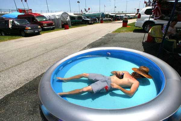 J.T. Thompson, of Myakka City, Fla., keeps cool at his camp in the infield near Turn 4 before the start of NASCAR's Sprint Cup series Coke Zero 400, at Daytona International Speedway, in Daytona Beach, Fla., Saturday, July 7, 2012.