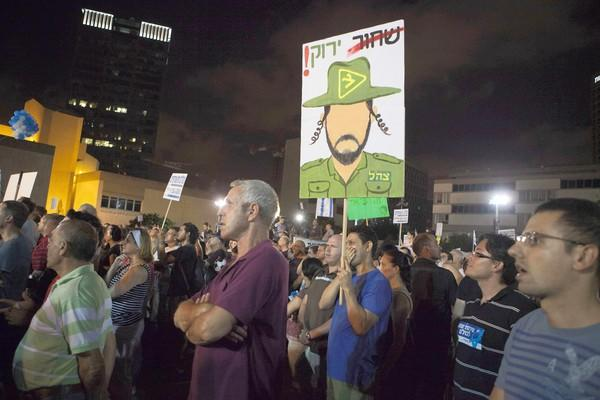 Israelis attend a rally July 7, 2012, in Tel Aviv to show support for universal conscription for Israeli military service.