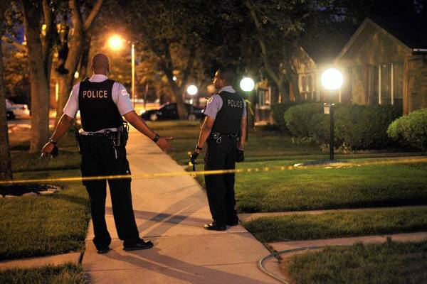 Chicago police investigate the scene where two girls were shot Tuesday night at 117th and Ada streets.