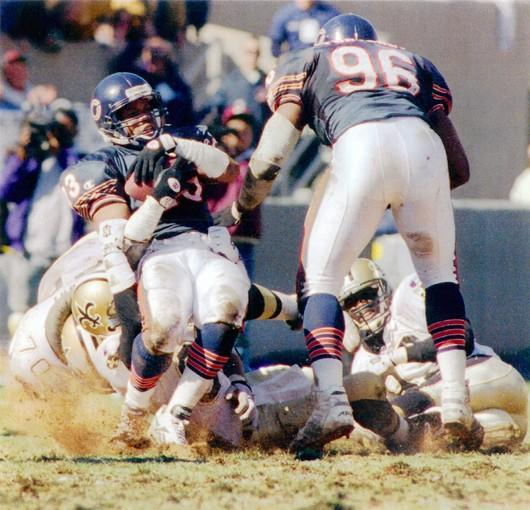 In 1994, Bears defensive back Shaun Gayle is tackled in a game against the New Orleans' Saints at Soldier Field.