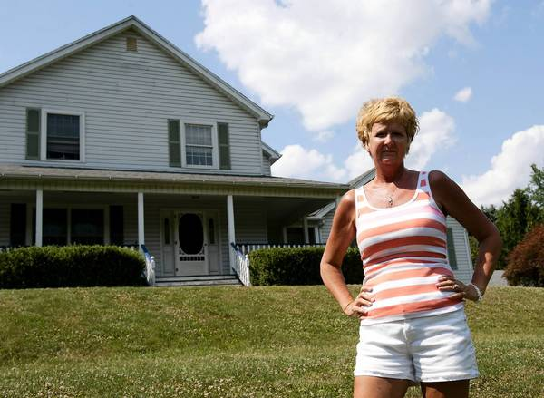 Abby Burns of Williams Township has learned her property is now part of a flood plain, a federal designation that requires flood insurance for mortgage holders.
