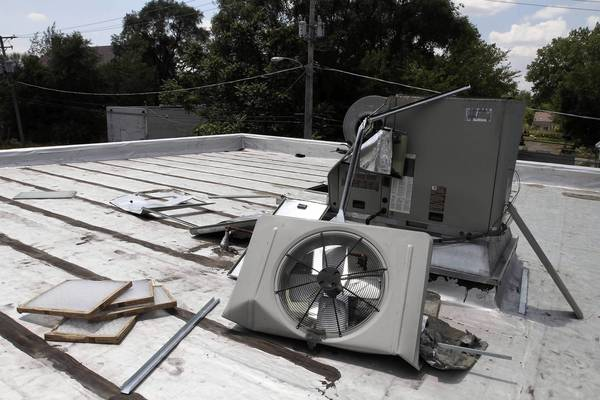 The rooftop air conditioner at the William Leonard Public Library in Robbins stands in shambles Wednesday.