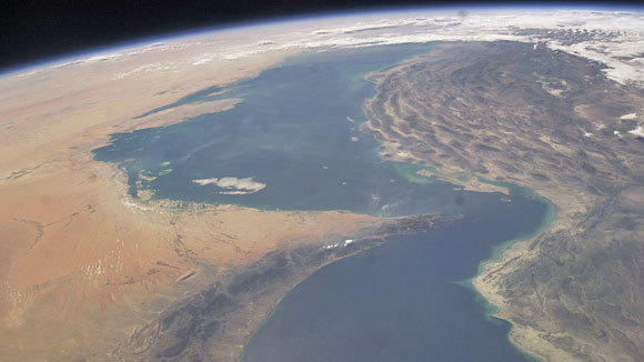 A photograph from the International Space Station shows the Strait of Hormuz connecting the Persian Gulf and the Gulf of Oman.