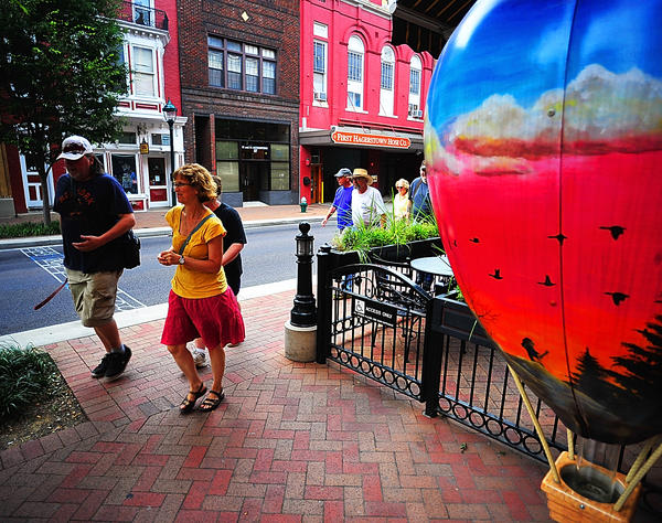 A tour group interested in the 1863 Civil War battle in Hagerstown marches through downtown Hagerstown Wednesday evening.
