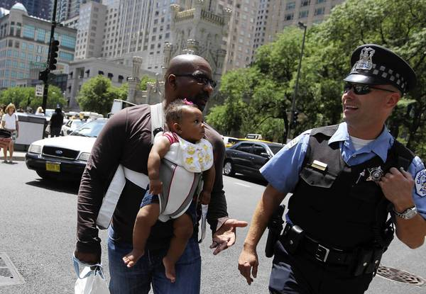Damascus Harris stops to chat with Chicago police officer Zack Sniezek along Michigan Avenue on Wednesday.