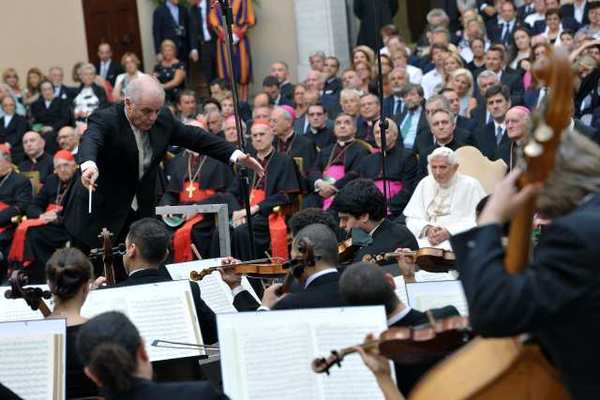 Daniel Barenboim conducts members of the West-Eastern Divan Orchestra near Rome as Pope Benedict XVI, seated at right, listens.