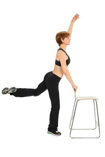 Raise your left arm up (just be sure your arm is not directly above your head, it should be slightly forward) and bend your right knee slightly.