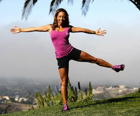 "Former Olympic sprinter Samantha Clayton demonstrates her ""left and open"" walking routine to challenge your balance and strengthen your core at her home in Malibu on July 8, 2012.fitness walking"