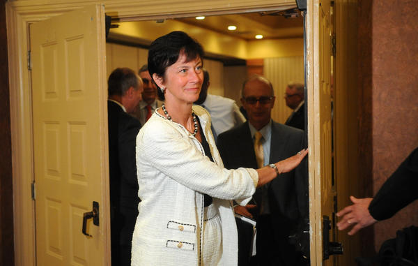 Chairman of the Board of Trustees Karen B. Peetz leaves a conference room at the Radisson Lackawanna Station Hotel Scranton Thursday morning after receiving the Freeh report on the Penn State's handling of the Jerry Sandusky sex scandal.