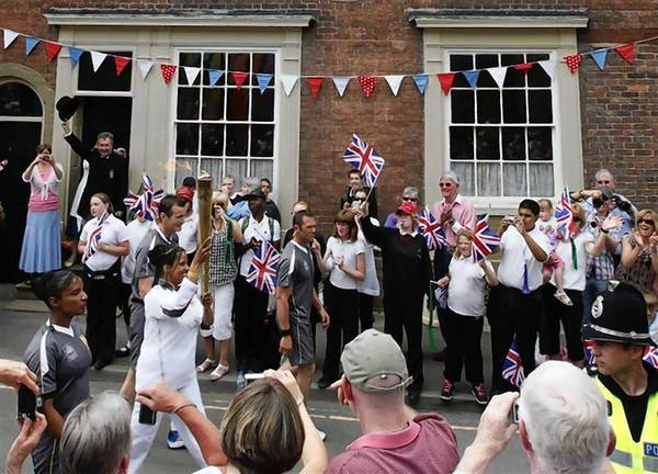 File photo of the Olympic torch passing the birthplace of William Penny Brookes, the founding father of the modern Olympics in Much Wenlock.