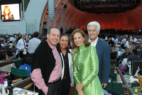 Gary and Kathy Darnell, left, visit with La Cañada residents Vicki and Kerry McCluggage at the Hollywood Bowl opening night gala concert. Vicki McCluggage is a vice chair on the Los Angeles Philharmonic Association board of directors.