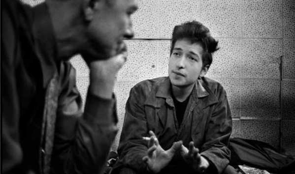 Bob Dylan, right, talks with Pete Seeger backstage at the Newport Folk Festival in 1965.