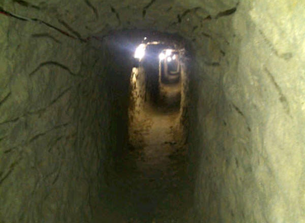 This image provided Thursday by the U.S. Immigration and Customs Enforcement shows a tunnel discovered in Tijuana that is designed to smuggle drugs into the United States.