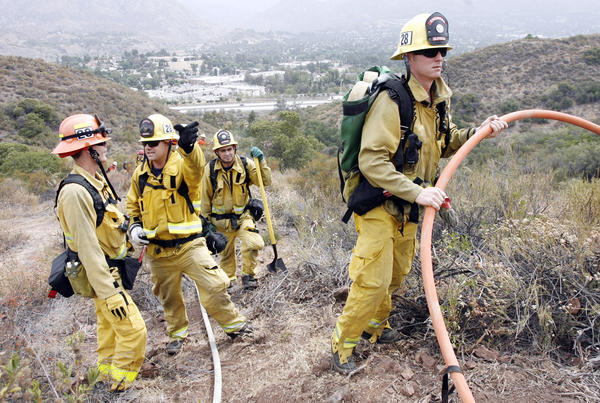 Glendale Fire Dept. Station #28 firefighters participate in a brush fire drill alongside L.A. City Fire Dept., L.A. County Fire Dept., and the USDA Forest Service on a hillside above Sunland Blvd. in Sunland on Thursday, July 12, 2012.