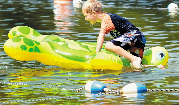 Luke Fair enjoys the cool water at Greenbrier State Park in Boonsboro. The park offers many activities for families.