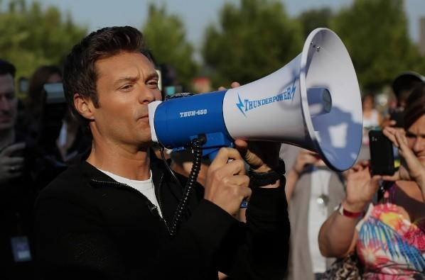 """Ryan Seacrest addresses the crowd before """"American Idol"""" auditions outside the United Center July 12, 2012."""