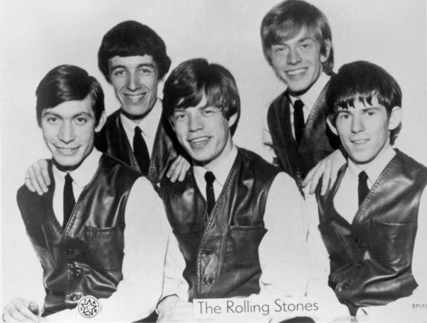 The Rolling Stones: The Rolling Stones in 1962 in London. Charlie Watts, left, Bill Wyman, Mick Jagger, Brian Jones and Keith Richards. (Photo by Michael Ochs Archives/Getty Images)